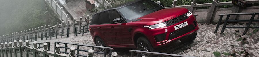 Red Range Rover Sport Climbing Stairs
