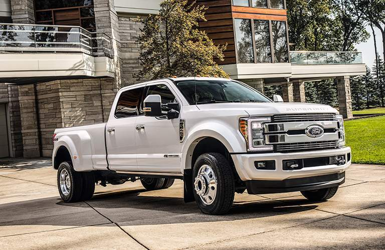 2018 Ford f-250 Super Duty in White parked outside of a beautiful house