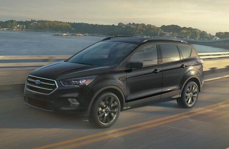 black 2018 Ford Escape driving across bridge