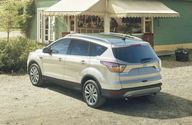 silver 2018 Ford Escape parked outside quaint restaurant