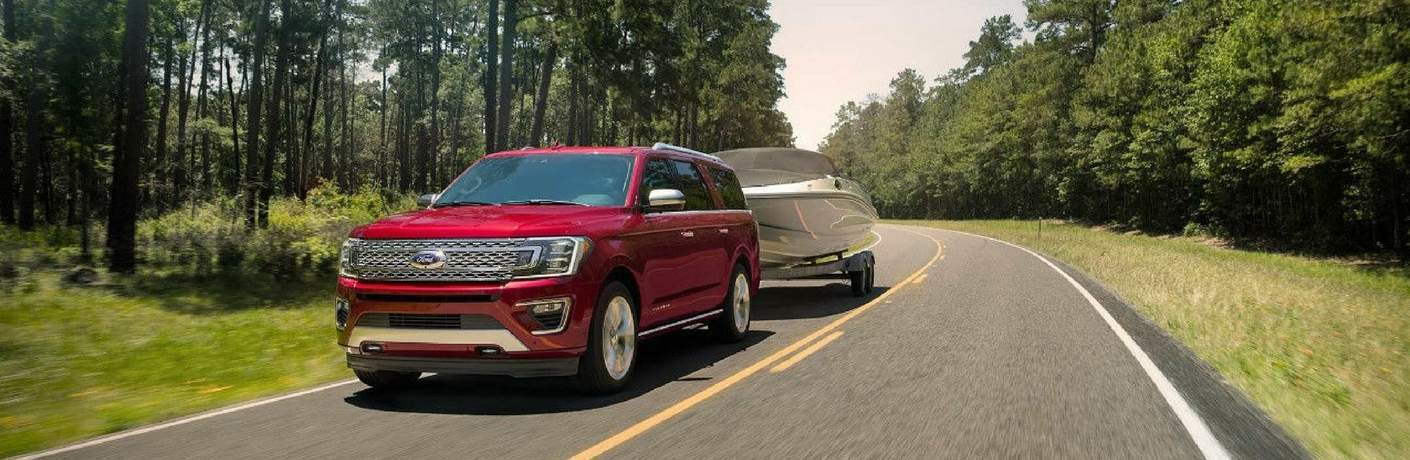 2018 Ford Expedition towing boat on country road