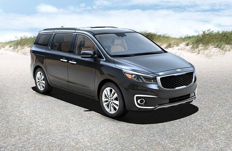 2018 Kia Sedona parked showing side and front profile