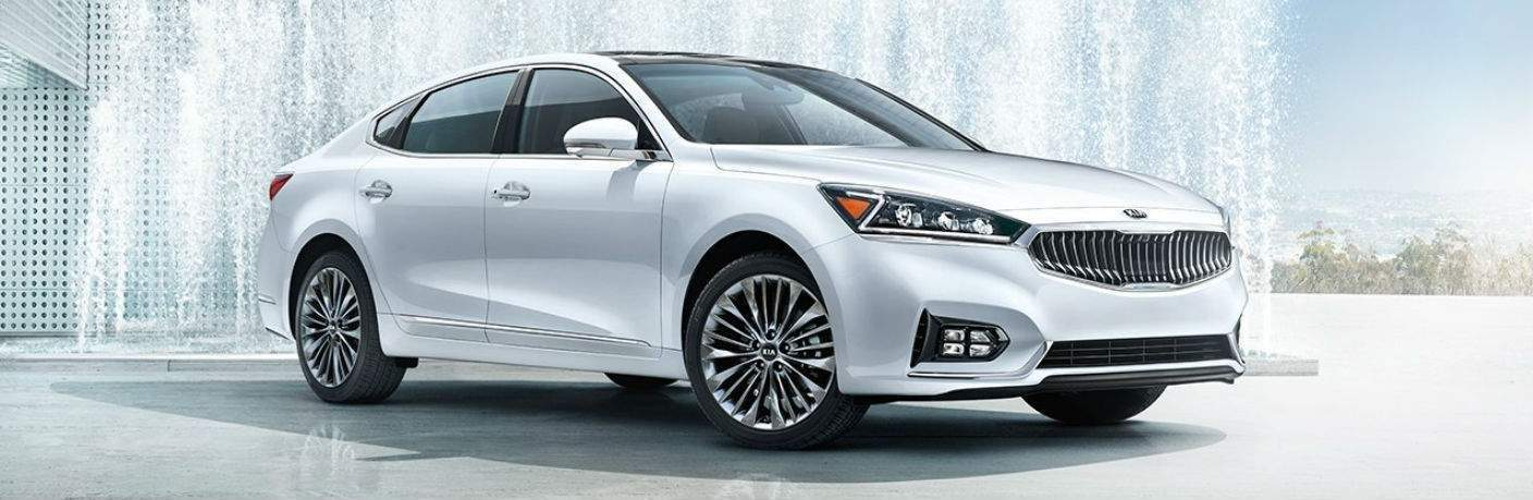 Full view of the 2018 Kia Cadenza parked by a fountain