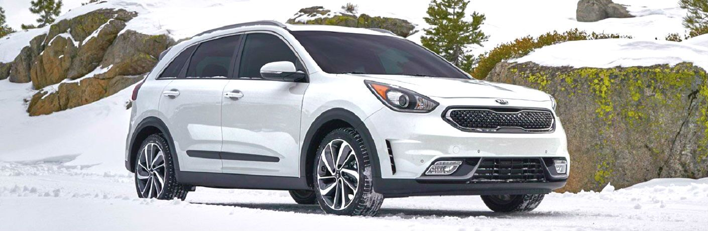 white 2019 kia niro on snow