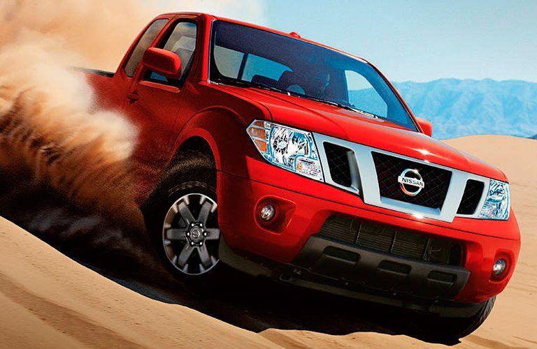 2018 Nissan Frontier driving through sand dunes