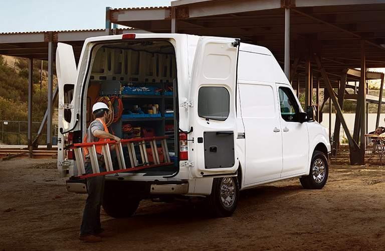 Man putting ladder into 2017 Nissan NV2500
