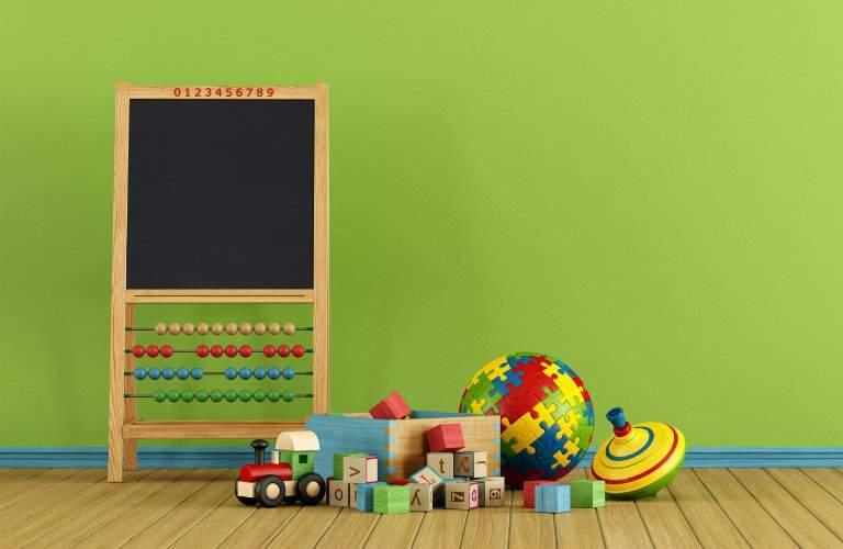 Blackboard with toys around it