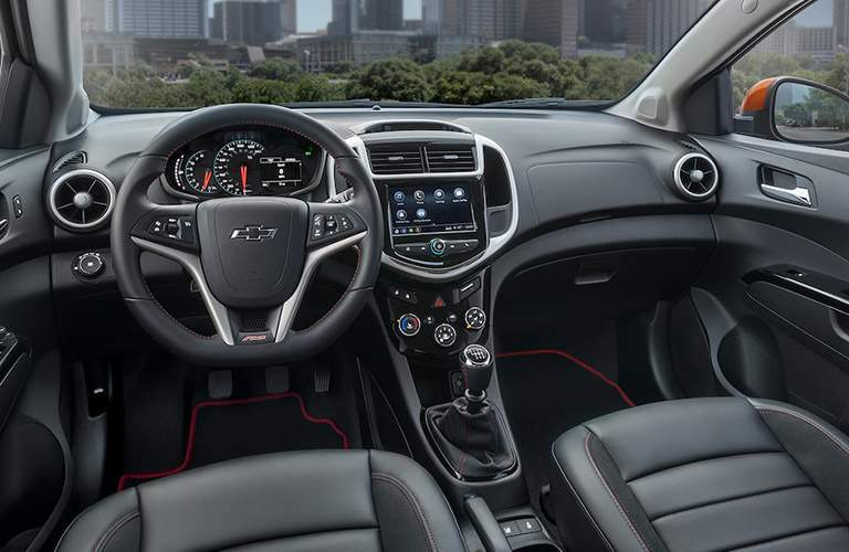 Interior of the 2018 Chevrolet Sonic focused on the infotainment system and the steering wheel