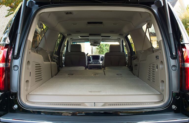 2018 Chevy Suburban exterior trunk open looking into cargo space seats folded down