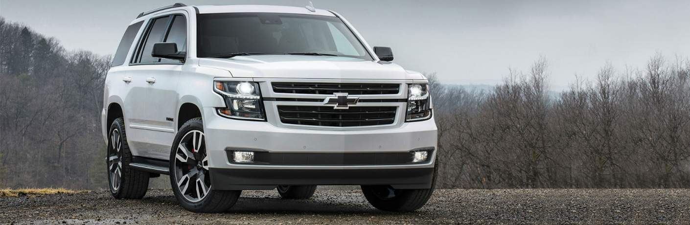 2018 Chevrolet Tahoe parked in front a a forest on a gray, foggy day