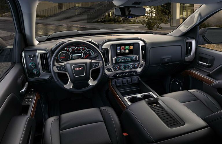 Front row interior fo the 2018 GMC Sierra 1500 with focus on the display system and center console