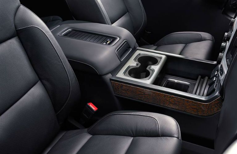 Center console and passenger seat in the front interior of the 2018 GMC Sierra 1500