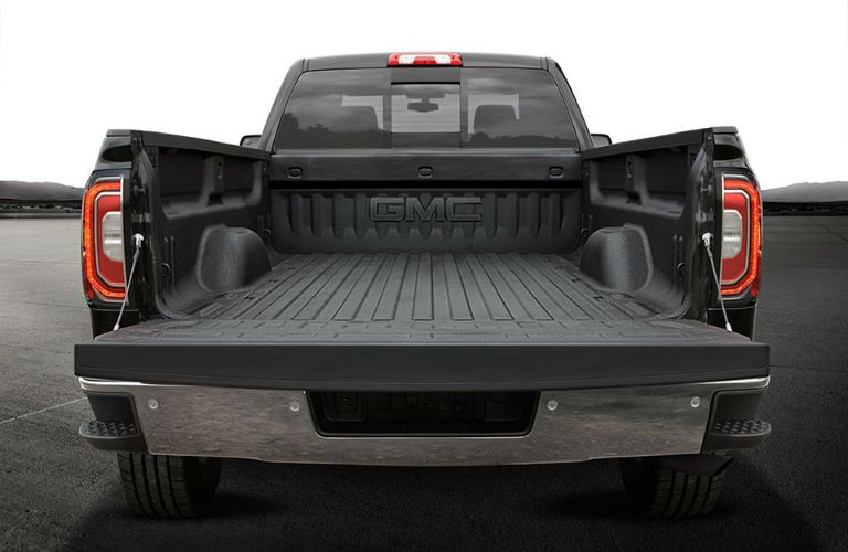 Box of the 2018 GMC Sierra 1500 with the tailgate open showing the liner