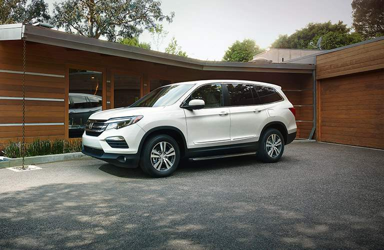 2017 Honda Pilot parked outside fancy house