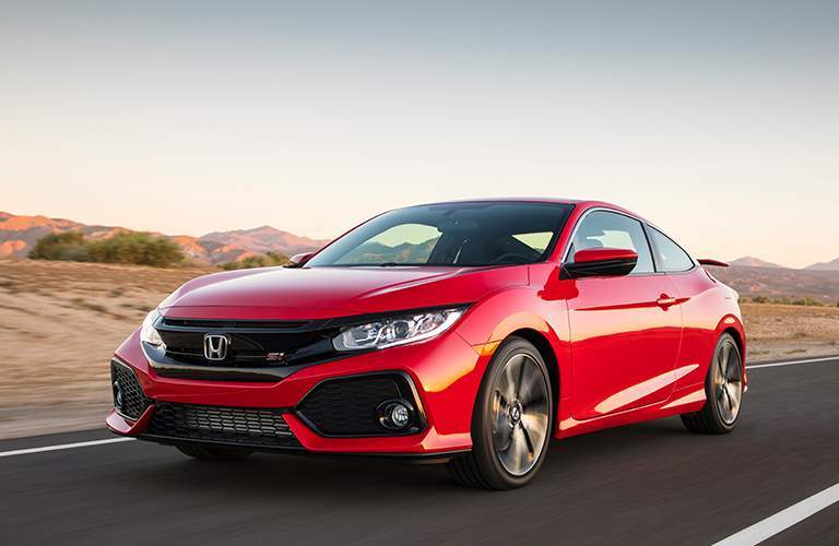 Red 2018 Honda Civic Si on a road by a desert