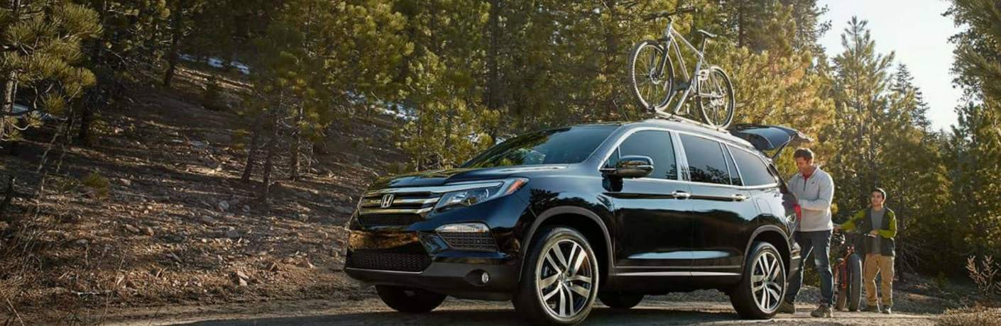 2018 Honda Pilot Hauling a Bike on the Roof