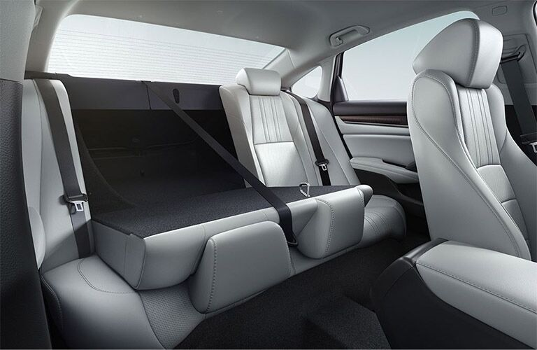 Interior view of the 60/40-split rear seat partially folded down in a 2019 Honda Accord