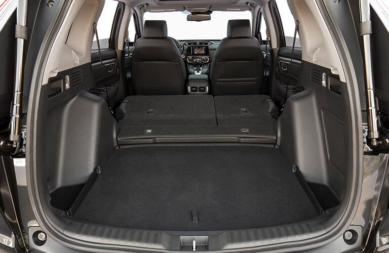 Interior view of a 2019 Honda CR-V showing the cargo space when the rear seats are folded flat