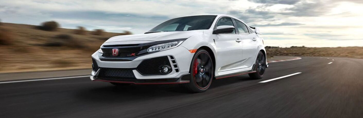 Exterior view of a white 2019 Honda Civic Type R driving around a race track