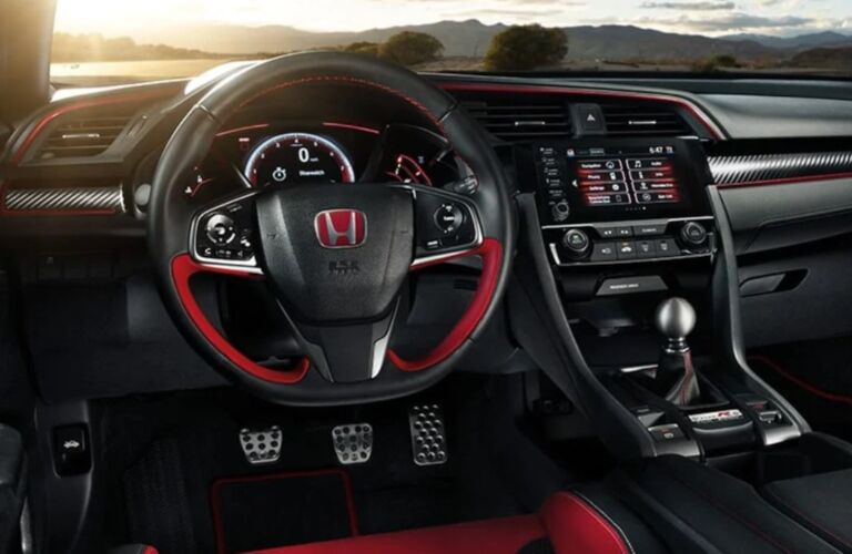 Interior view of the steering wheel, dashboard, and touchscreen inside a 2019 Honda Civic Type R