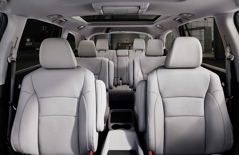 Interior view of the beige three rows of seating inside a 2019 Honda Pilot
