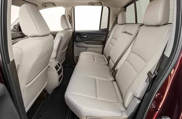 Interior view of the tan seating in the rear of a 2019 Honda Ridgeline