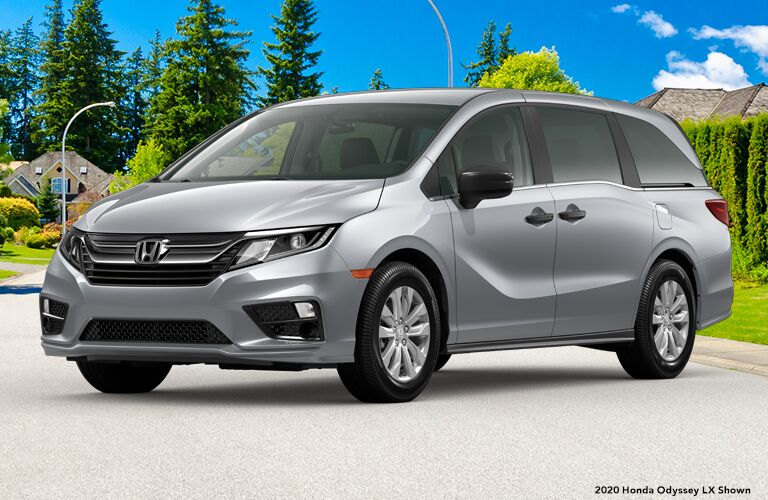 2020 Honda Odyssey LX parked on concrete against concept background