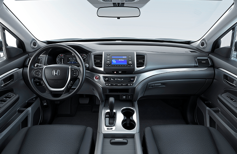 2020 Honda Ridgeline interior showing bottoms of front seats, steering wheel, center console and screen