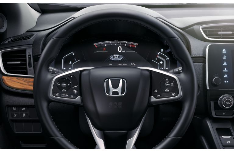 2020 Honda CR-V Touring close up of steering wheel and wood accent