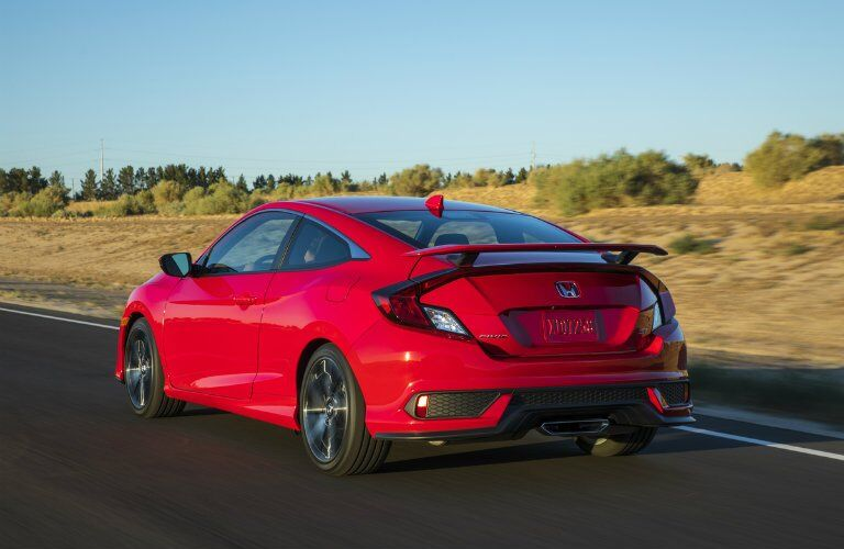 2017 Honda Civic Si driving down the highway