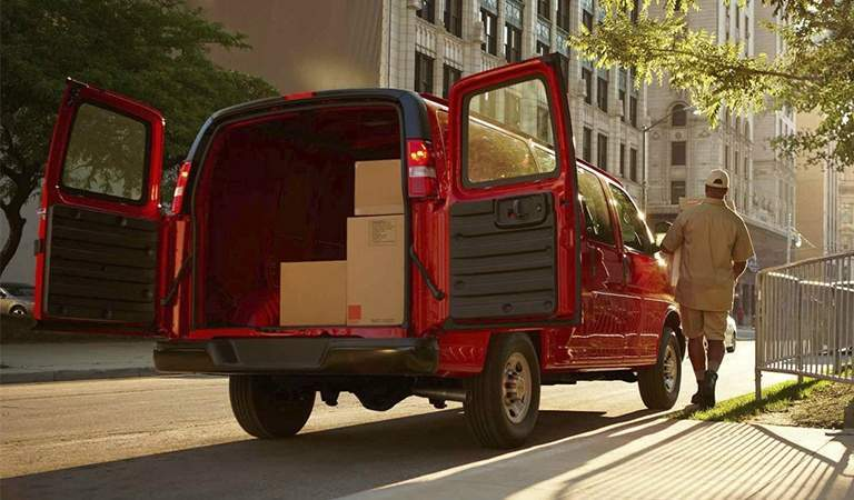 2017 Chevy Express red with back doors open