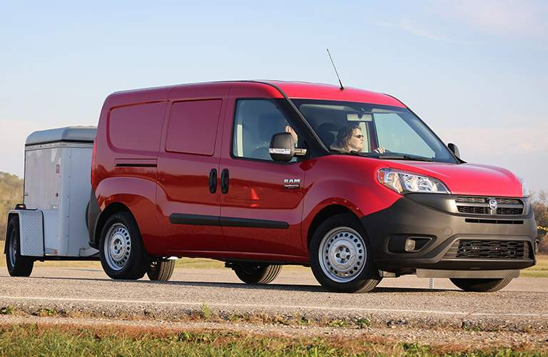 2018 Ram ProMaster City cargo red towing a trailer side view