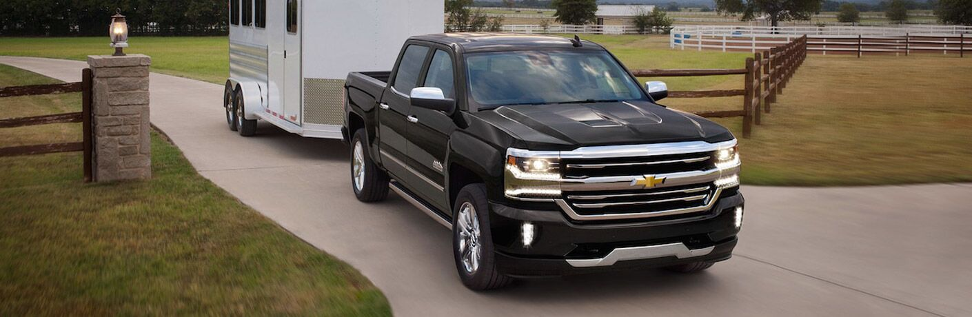 2018 Chevrolet Silverado 1500 Front View of Black Exterior Towing a White Trailer