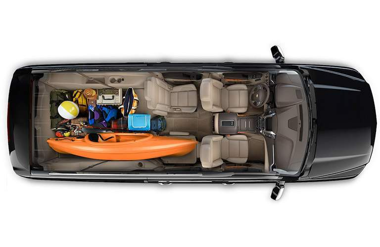 overhead view of chevy suburban cargo space with camping gear and kayak