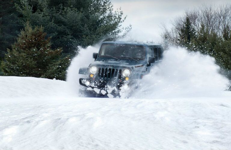 front view of 2018 Jeep Wrangler JK driving through snow