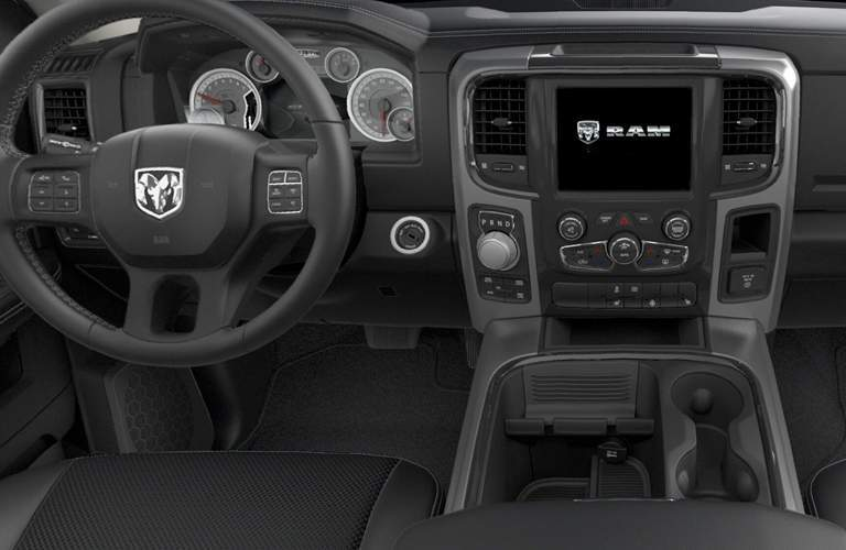 Steering wheel and center touchscreen of 2018 RAM 1500 with center console in view