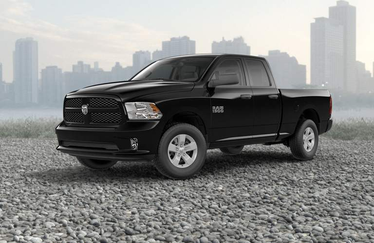 Front view of black 2018 RAM 1500 on gravelly terrain