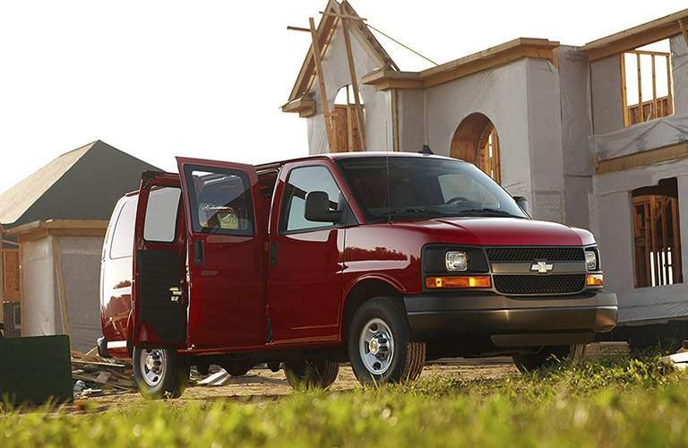 2018 Chevy Express red side view with side doors open