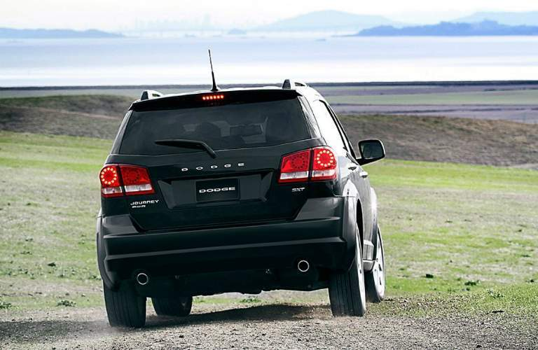 2018 dodge journey driving in a field
