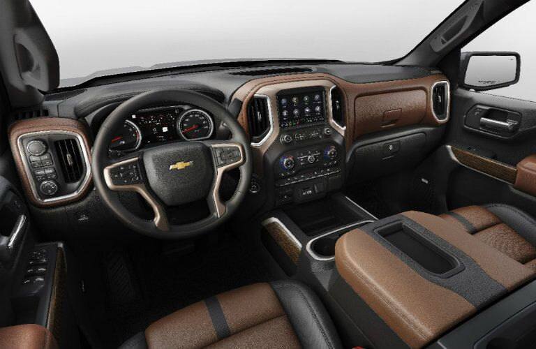 2019 Chevy Silverado 1500 brown leather seating with steering wheel and dashboard