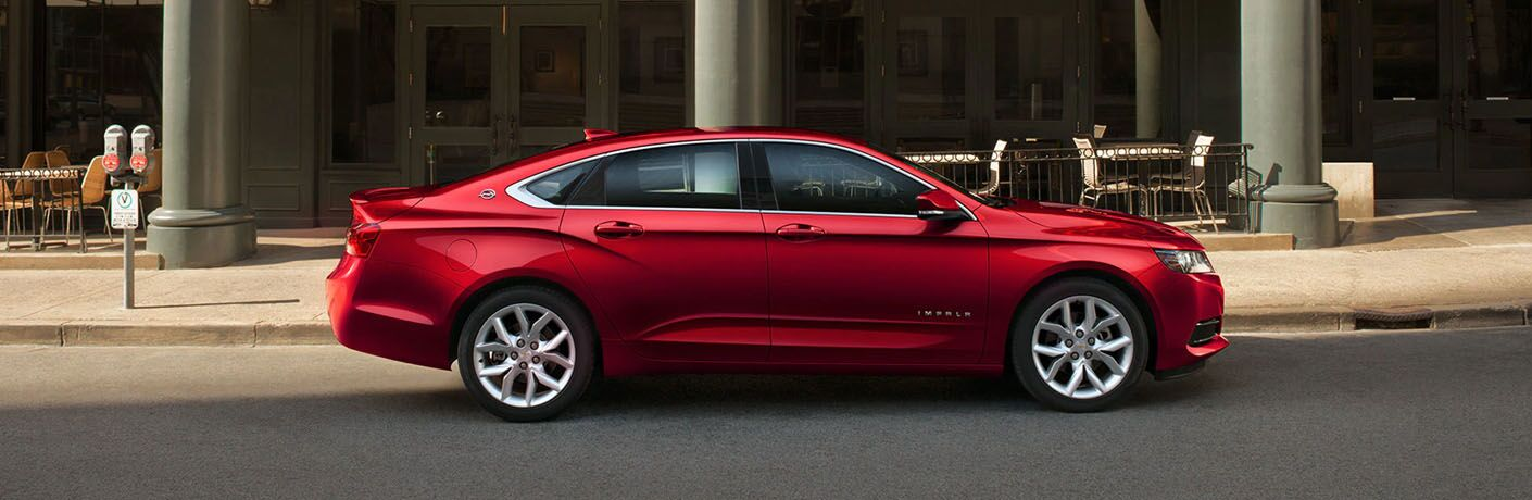 full view of red 2019 impala parked