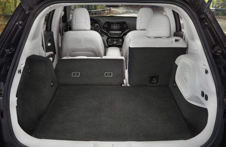 cargo area of 2019 Jeep Cherokee with part of rear seat folded flat