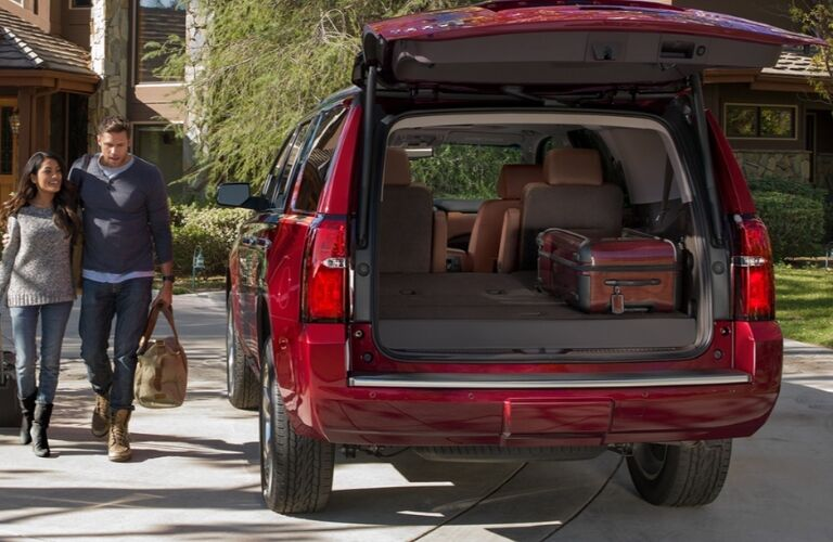 couple walking up to open liftgate on 2020 tahoe