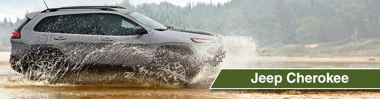 2018 Jeep Cherokee driving through a puddle