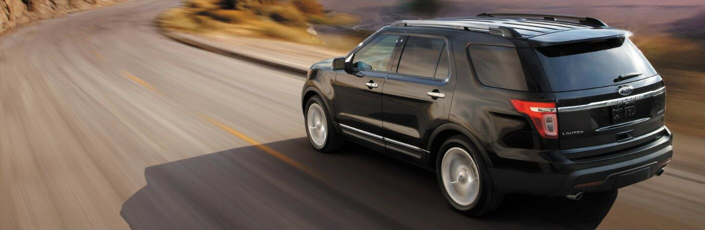 2014 Ford Explorer driving on winding highway road