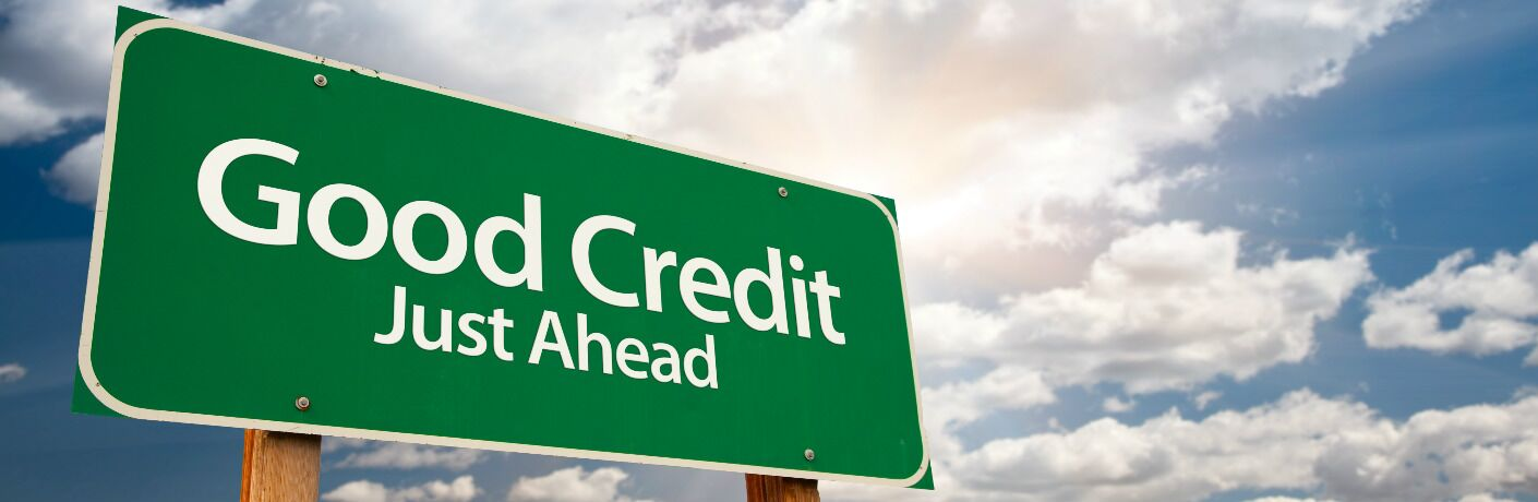 Good Credit Just Ahead road sign with a sunny and cloudy blue sky in the background