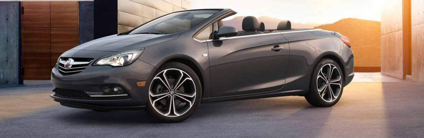 2018 Buick Cascada convertible parked near a building at sunset