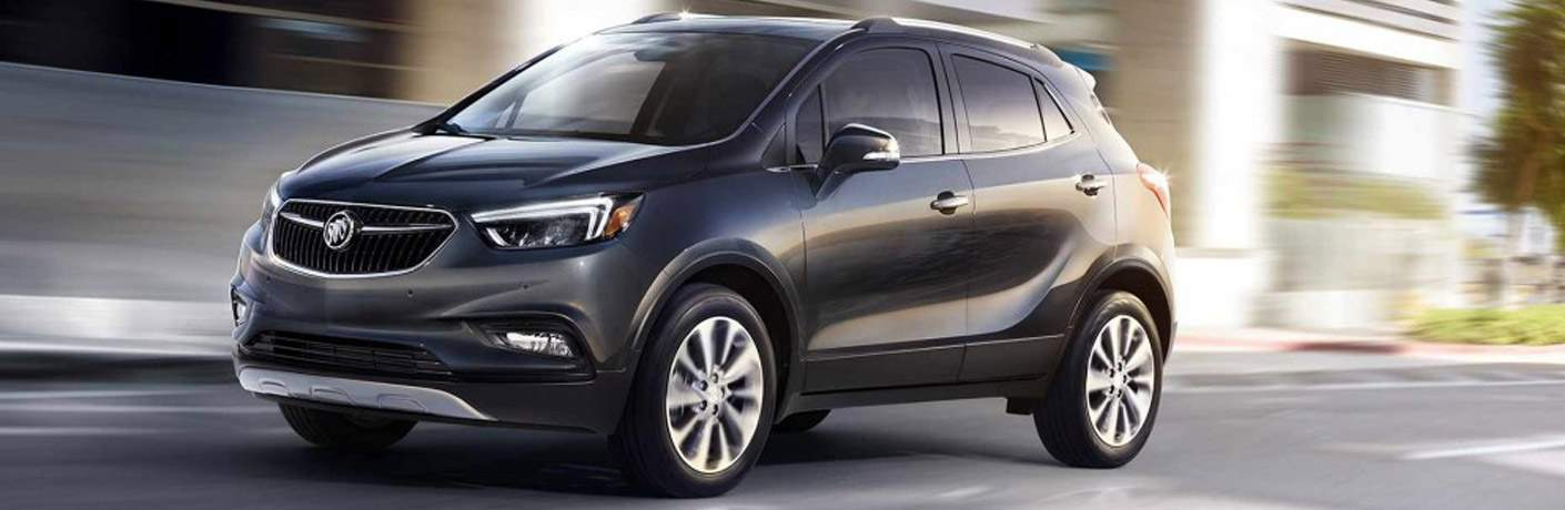 2018 Buick Encore driving down a blurred street