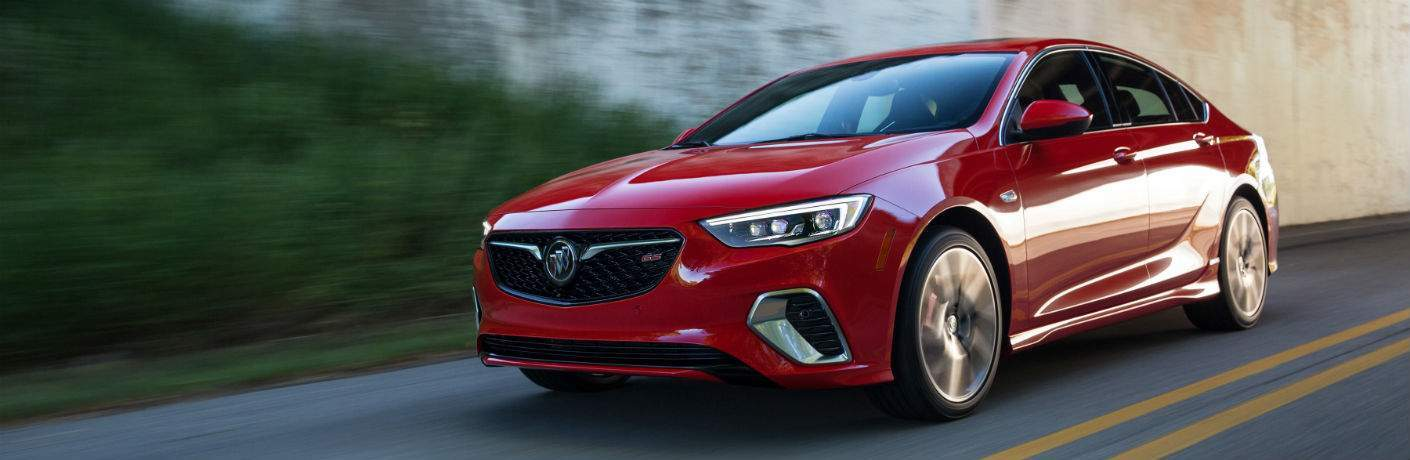 2018 Buick Regal in red driving down the road