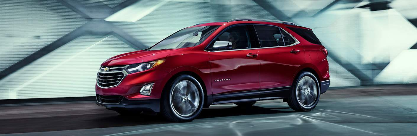 Red Chevy Equinox driving through a concrete tunnel